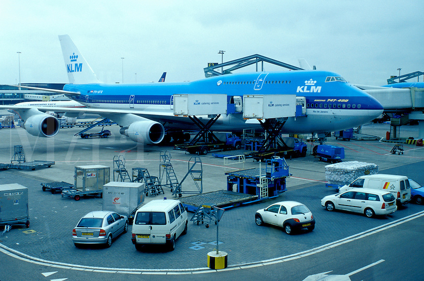 KLM, airport, Schiphol, Amsterdam, The Netherlands, Holland, Europe, KLM Royal Dutch Airline passenger plane is parked outside the terminal at Schiphol International Airport in Amsterdam.