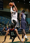 Reno Bighorns' Ray McCallum shoots over Bakersfield Jam's Aaron Johnson and Mac Koshwal during a D-League basketball game in Reno, Nev., on Tuesday, Jan. 14, 2014. The Bighorns won 93-85.<br /> Photo by Cathleen Allison