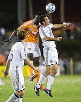 Houston Dynamo forward Ade Akinbiyi (14) and D.C. United midfielder Andrew Jacobson (8) go up for the header.  Houston Dynamo defeated D.C. United 4-3 at Robertson Stadium in Houston, TX on August 1, 2009.