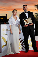 CANNES, FRANCE - JULY 17: Camera d'Or jury president Melanie Thierry and Frank Graziano pose with the 'Camera d'Or Award' for 'Murina' in the name of Antoneta Alamat Kusijanovic during the 74th annual Cannes Film Festival on July 17, 2021 in Cannes, France.<br /> CAP/GOL<br /> ©GOL/Capital Pictures