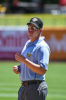 Umpire Stu Scheurwater handles the calls on the bases during the Pacific Coast League game between the Salt Lake Bees and the El Paso Chihuahuas at Smith's Ballpark on July 26, 2015 in Salt Lake City, Utah. El Paso defeated Salt Lake 6-3 in 10 innings.  (Stephen Smith/Four Seam Images)