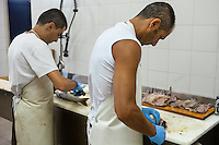 After extraction of the eggs, mullet is filleted and the meat is dried - Cabras, Sardinia.