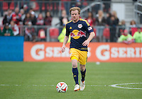 Toronto, Ontario - May 17, 2014: New York Red Bulls midfielder Dax McCarty #11in action during a game between the New York Red Bulls and Toronto FC at BMO Field. Toronto FC won 2-0.