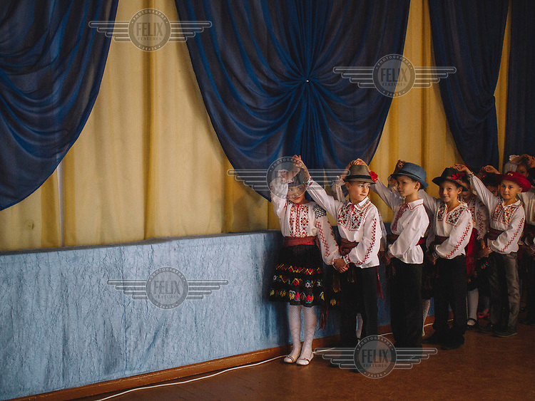 Children perform national dances during a concert on Teacher's Day, an annual appreciation of educators .
