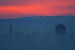 A red sky painted over the San Francisco skyline.