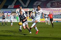24th April 2021; Dens Park, Dundee, Scotland; Scottish Championship Football, Dundee FC versus Raith Rovers; Reghan Tumilty of Raith Rovers and Jason Cummings of Dundee