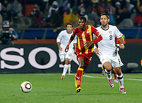 Clint Dempsey of the USA and John Pantsil of Ghana. USA vs Ghana in the 2010 FIFA World Cup at Royal Bafokeng Stadium in Rustenburg, South Africa on June 26, 2010.