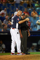 Reading Fightin Phils manager Dusty Wathan (62) argues a strike three call with umpire Paul Clemons during a game against the New Britain Rock Cats on August 7, 2015 at FirstEnergy Stadium in Reading, Pennsylvania.  Reading defeated New Britain 4-3 in ten innings.  (Mike Janes/Four Seam Images)