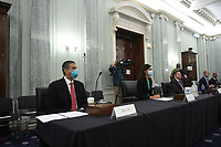 Ajit Pai, Chairman, Federal Communications Commission (FCC), left, testifies with other FCC Commissioners during a United States Senate Committee on Commerce, Science, and Transportation oversight hearing to examine the Federal Communications Commission in Washington, DC on June 24, 2020. <br /> Credit: Jonathan Newton / Pool via CNP/AdMedia
