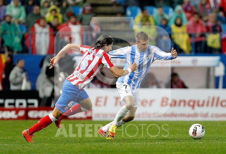 Atletico de Madrid's Filipe Luis and Malaga's Joaquin Sanchez during La Liga match, 2012/May/05..(ALTERPHOTOS/ARNEDO & ALCONADA)