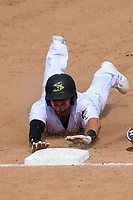 Beloit Snappers third baseman Kole Enright (8) slides into third base during a game against the Quad Cities River Bandits on July 18, 2021 at Pohlman Field in Beloit, Wisconsin.  (Brad Krause/Four Seam Images)