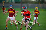 Ballyheigue's darren Stack clears his defence despite the attention from Ciaran Lucey of Duagh in the final of the 2020 Junior hurling championship.