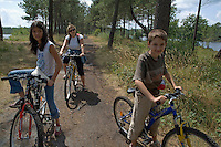 Family mountain biking in Landes Forest, Aquitaine, France.