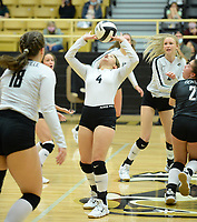 Bentonville's Maddy Hughes (4) sets the ball Tuesday, Sept. 15, 2020, during play against Fayetteville in Tiger Arena in Bentonville. Visit nwaonline.com/200916Daily/ for today's photo gallery. <br /> (NWA Democrat-Gazette/Andy Shupe)