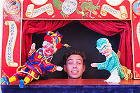 BNPS.co.uk (01202 558833)<br /> Pic: JoeBurns/BNPS<br /> <br /> Pictured: Punch and Judy performer Joe Burns.<br /> <br /> Britain's seaside resorts could lose their last remaining Punch and Judy shows because of shocking abuse from onlookers.<br /> <br /> The iconic century old tradition is at risk of extinction as two of the country's last three shows are bombarded by insults from angry families refusing to donate just £2 to watch.<br /> <br /> Such donations are essential for the survival of the puppet shows, which rely entirely on public generosity to keep going.