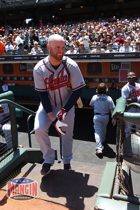 SAN FRANCISCO, CA - MAY 12:  Brian McCann #16 of the Atlanta Braves gets ready in the dugout before the game against the San Francisco Giants at AT&T Park on Sunday, May 12, 2013 in San Francisco, California. Photo by Brad Mangin