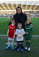 ATTENTION SPORTS PICTURE DESK<br /> Pictured: Paulo Sousa Manager of Swansea City with mascots <br /> Re: Coca Cola Championship, Swansea City Football Club v Nottingham Forest at the Liberty Stadium, Swansea, south Wales. Saturday 12 December 2009
