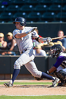 Jared Schlehuber (24) of the Wilmington Blue Rocks follows through on his swing against the Winston-Salem Dash at BB&T Ballpark on July 6, 2014 in Winston-Salem, North Carolina.  The Dash defeated the Blue Rocks 7-1.   (Brian Westerholt/Four Seam Images)