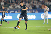 CARSON, CA - SEPTEMBER 15: Matt Besler #5 of Sporting Kansas City moves with the ball during a game between Sporting Kansas City and Los Angeles Galaxy at Dignity Health Sports Complex on September 15, 2019 in Carson, California.
