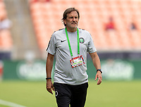 HOUSTON, TX - JUNE 10: Randy Waldrum of Nigeria watches his team during a game between Nigeria and Jamaica at BBVA Stadium on June 10, 2021 in Houston, Texas.