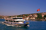 A boat travels down the Bosphorus river in Istanbul, Turkey.