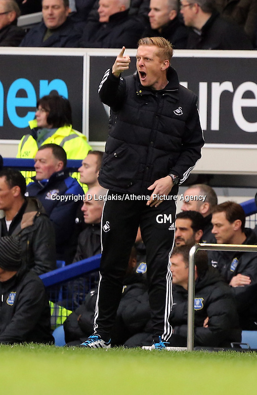 Pictured: Swansea manager Garry Monk shouts instructions to his players. Saturday 22 March 2014<br /> Re: Barclay's Premier League, Everton v Swansea City FC at Goodison Park, Liverpool, UK.