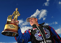 Apr. 1, 2012; Las Vegas, NV, USA: NHRA funny car driver Robert Hight celebrates after winning the Summitracing.com Nationals at The Strip in Las Vegas. Mandatory Credit: Mark J. Rebilas-
