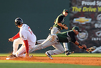 Second baseman Jose Cuevas (15) of the Augusta GreenJackets reaches for the wide throw as Garin Cecchini (17) of Greenville Drive steals second base on April 19, 2012, at Fluor Field at the West End in Greenville, South Carolina. (Tom Priddy/Four Seam Images)