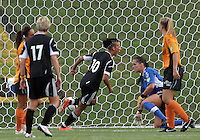 BOYDS, MARYLAND-JULY 07,2012:  Lianne Sanderson (10) of DC United Women shoots the ball past Ashley Daniels (12) Dayton Dutch Lions for the first United goal during a W League game at Maryland Soccerplex, in Boyds, Maryland. DC United women won 4-1.