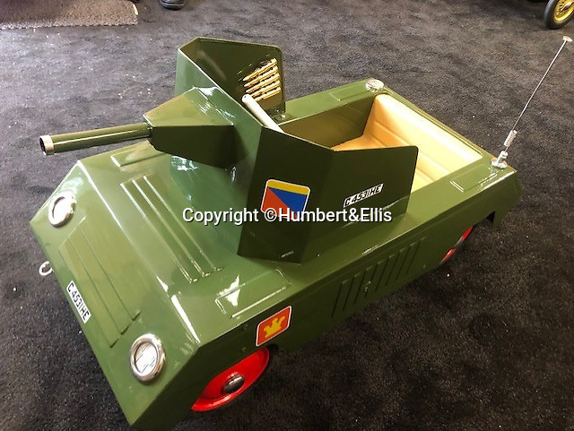 BNPS.co.uk (01202 558833)<br /> Pic: Humbert&Ellis/BNPS<br /> <br /> Est. £1,550 - Tri-ang armoured pedal car.<br /> <br /> £200,000 of pedal power...<br /> <br /> A remarkable single owner collection of over 85 vintage toy cars has emerged for sale for £200,000.<br /> <br /> The fleet of rare pedal cars which were acquired over half a century form what is thought to be the biggest private collection of its kind in the world.<br /> <br /> It includes child car models of Rolls Royces, Bugattis and Bentleys, as well as a quirky amphibian car. <br /> <br /> The collection has been consigned for sale with Humbert & Ellis Auctioneers by a retired businessman in his 80s.<br /> <br /> He travelled all over the world to get his hands on the cars, and built a barn next to his Devon home to display them in.