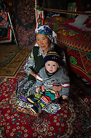 Mongolia, Bayan-Ulgii, Ulgii, Altai Mountains. Woman and baby.