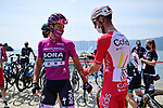 Maglia Ciclamion Peter Sagan (SVK) Bora-Hansgrohe and Fabio Sabatini (ITA) Cofidis chat as they wait to sign on before the start of Stage 20 of the 2021 Giro d'Italia, running 164km from Verbania to Valle Spluga-Alpe Motta, Italy. 29th May 2021.  <br /> Picture: LaPresse/Massimo Paolone   Cyclefile<br /> <br /> All photos usage must carry mandatory copyright credit (© Cyclefile   LaPresse/Massimo Paolone)