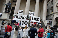"""Activists gather as part of a Flash Mob on the steps of Federal Hall in New York City to tell Wall Street that """"America's Not Broke"""" on 06 June 2011.  The action was planned after video emerged of the Fox News ticker getting hacked earlier in the week."""