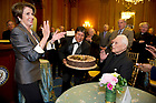 May 22, 2013; House Democratic leader Nancy Pelosi, presents the birthday cake to University President Emeritus Rev. Theodore M. Hesburgh, C.S.C., during a special reception celebrating his 96th birthday in the Rayburn Room of the U.S. Capitol. The reception was also held to a honor his 70th anniversary as a priest of the Congregation of Holy Cross. Photo by Barbara Johnston/University of Notre Dame