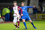 Hearts v St Johnstone....11.01.11  Scottish Cup.David Templeton holds off Chris Millar.Picture by Graeme Hart..Copyright Perthshire Picture Agency.Tel: 01738 623350  Mobile: 07990 594431