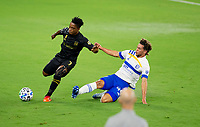 LOS ANGELES, CA - SEPTEMBER 02: Cade Cowell #44 of the San Jose Earthquakes attempts a slide tackle on Latif Blessing #7 of LAFC while LAFC head coach Bob Bradley looks on during a game between San Jose Earthquakes and Los Angeles FC at Banc of California stadium on September 02, 2020 in Los Angeles, California.