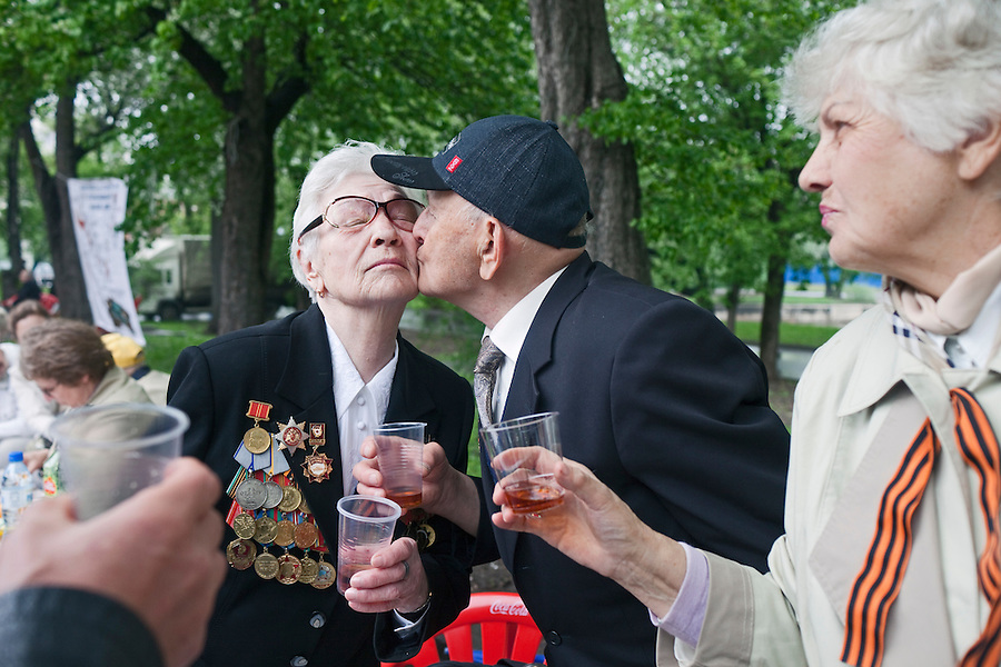 Moscow, Russia, 09/05/2012..Two military veterans kiss as Russian World War Two veterans and well-wishers gather in Gorky Park during the countrys annual Victory Day celebrations.