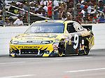 Marcos Ambrose, driver of the (9) Stanley Ford, in action during the Samsung Mobile 500 Sprint Cup race at Texas Motor Speedway in Fort Worth,Texas.