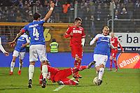 Luca Caldirola (Darmstadt) blockt den Schuss von Anthony Modeste (Koeln) - SV Darmstadt 98 vs. 1. FC Koeln, Stadion am Boellenfalltor
