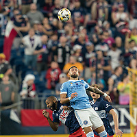 FOXBOROUGH, MA - SEPTEMBER 11: Andrew Farrell #2 of New England Revolution and Valentin Castellanos #11 of New York City FC battle for head ball during a game between New York City FC and New England Revolution at Gillette Stadium on September 11, 2021 in Foxborough, Massachusetts.
