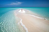 Woman on samll sand island. Turks and Caicos. Providenciales