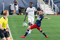 FOXBOROUGH, UNITED STATES - AUGUST 20: Alexander Buttner #28 of New England Revolution tries to intercept a ball near the sideline during a game between Philadelphia Union and New England Revolution at Gilette on August 20, 2020 in Foxborough, Massachusetts.