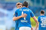 20.02.2021, xtgx, Fussball 3. Liga, FC Hansa Rostock - SV Waldhof Mannheim, v.l. Lukas Scherff (Rostock), Damian Rossbach (Hansa Rostock, 4) Jubel ueber den Sieg, Jubel nach Spielende <br /> <br /> (DFL/DFB REGULATIONS PROHIBIT ANY USE OF PHOTOGRAPHS as IMAGE SEQUENCES and/or QUASI-VIDEO)<br /> <br /> Foto © PIX-Sportfotos *** Foto ist honorarpflichtig! *** Auf Anfrage in hoeherer Qualitaet/Aufloesung. Belegexemplar erbeten. Veroeffentlichung ausschliesslich fuer journalistisch-publizistische Zwecke. For editorial use only.