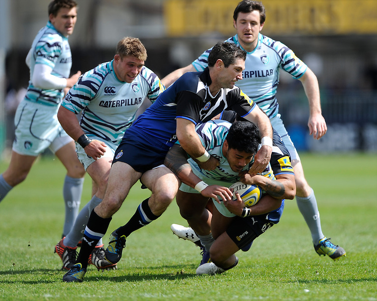 Manusamoa Tuilagi of Leicester Tigers is tackled by Stephen Donald (left) and Kyle Eastmond of Bath Rugby during the Aviva Premiership match between Bath Rugby and Leicester Tigers at The Recreation Ground on Saturday 20th April 2013 (Photo by Rob Munro)