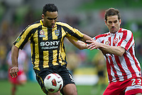 MELBOURNE, AUSTRALIA - SEPTEMBER 19, 2010: Paul Ifill from the Phoenix and Dean Heffernan from the Heart fight for the ball in Round 7 of the 2010 A-League between the Melbourne Heart and Wellington Phoenix at AAMI Park on September 19, 2010 in Melbourne, Australia. (Photo by Sydney Low / Asterisk Images)