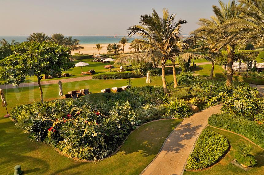 Dubai.  Gardens and beach at the Ritz Carlton Hotel at Jumeirah Beach..