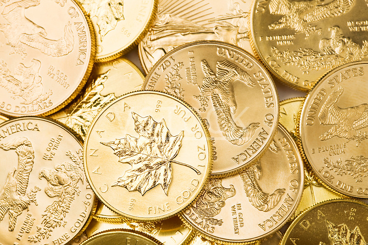 Canadian coins on white background