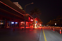 FORT LAUDERDALE, FL - APRIL 26: COVID-19: Fort Lauderdale Entertainment district which is normally packed with club and Restaurant goers is an eerie ghost town During The Coronavirus Pandemic on Saturday night April 26, 2020 after Florida Gov. Ron DeSantis orders all entertainment venues, restaurants, and beaches to close in Broward and Palm Beach Counties weeks ago in an effort to slow the spread of the Coronavirus on April 26, 2020 in Fort Lauderdale, Florida<br /> <br /> People:  A1A