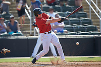 Gunnar Troutwine (37) of the Kannapolis Intimidators follows through on his swing against the Delmarva Shorebirds at Kannapolis Intimidators Stadium on May 19, 2019 in Kannapolis, North Carolina. The Shorebirds defeated the Intimidators 9-3. (Brian Westerholt/Four Seam Images)