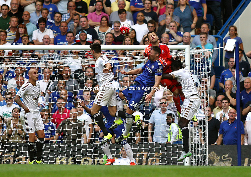 Lukasz Fabianski of Swansea punches the ball away  during the Barclays Premier League match between  Chelsea and Swansea  played at Stamford Bridge, London